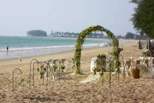 Stunning floral arch in for a beach wedding in Phuket by Toom from Wedding flowers Phuket