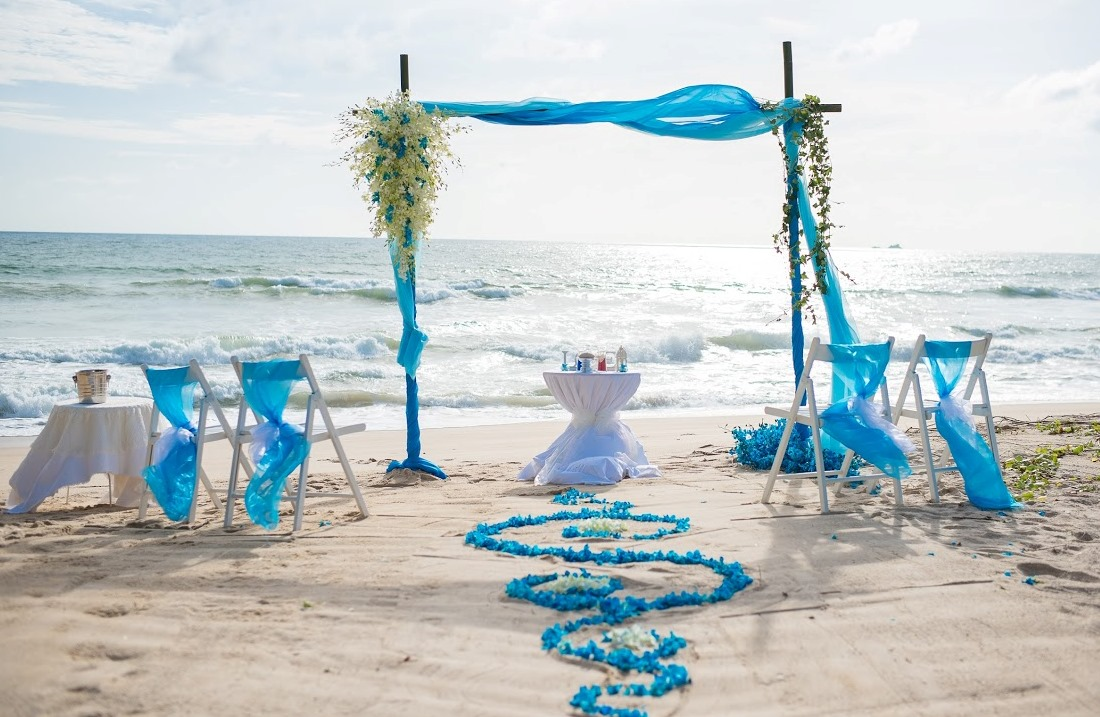 Beach wedding bamboo arch and beautifully decorated aisle for beach wedding in Phuket.