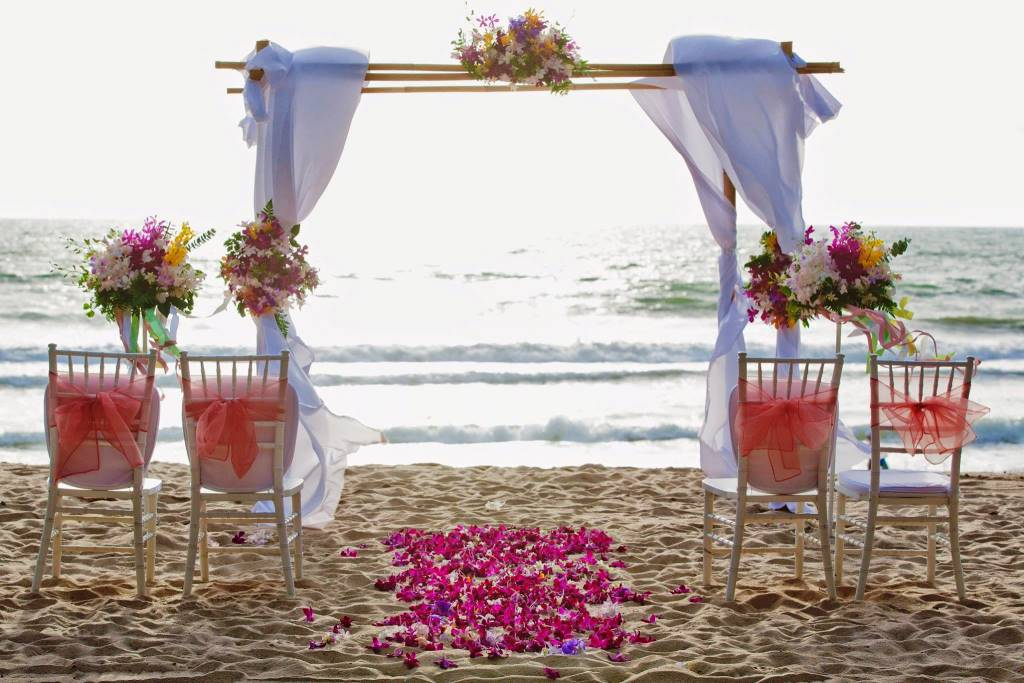 Bamboo and floral archway for a relaxed beach wedding in Phuket