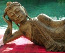 Hand carved reclining Buddha