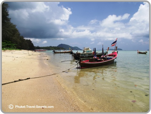 Longtail boats along the beach at Rawai to take visitors to the offshore island
