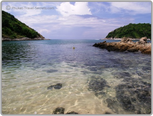 Snorkeling in the clear calm waters at Yanui.