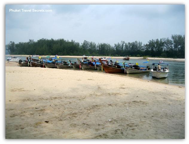 Longtail Boats at the pier at Nopparat Thara Beach.