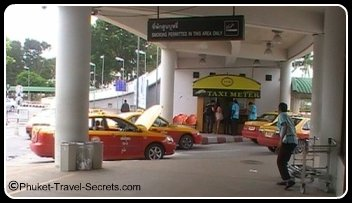 Metered Taxi stand and Taxis at Phuket International Airport.