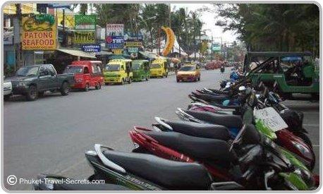 Patong Beach Road, Jeeps and Motorcycle hire and colourful Tuk Tuks