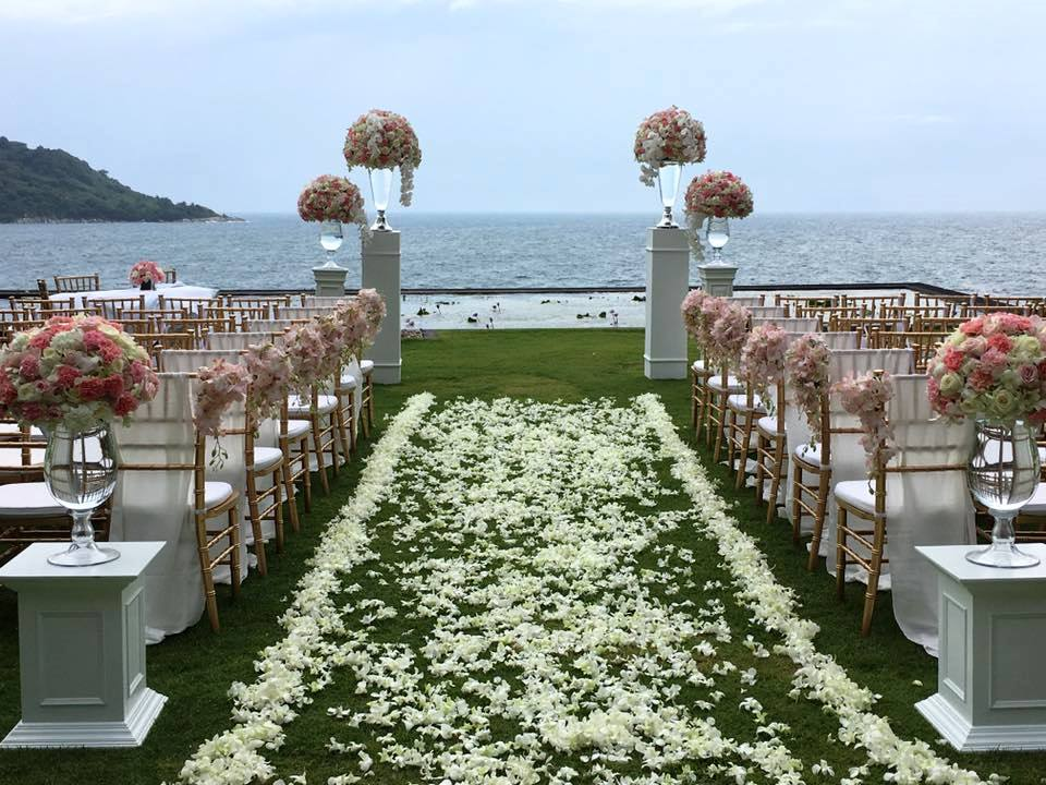 Flower stands and aisle flowers for a villa wedding in Phuket
