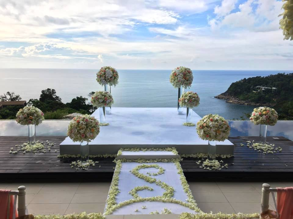 Flower stands used as the wedding backdrop for this wedding in Phuket
