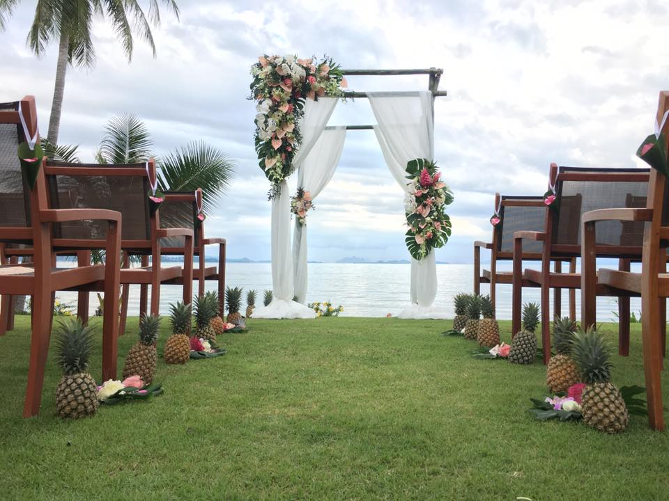 Pineapples used to line the aisle for a wedding in Phuket.