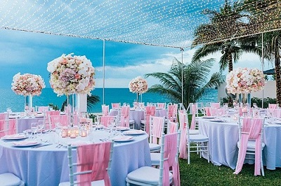 Beautifully decorated reception tables for a wedding in Phuket