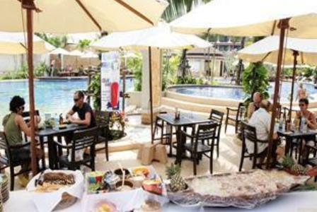 Poolside Dining at the Alpina Phuket Nalina Resort.