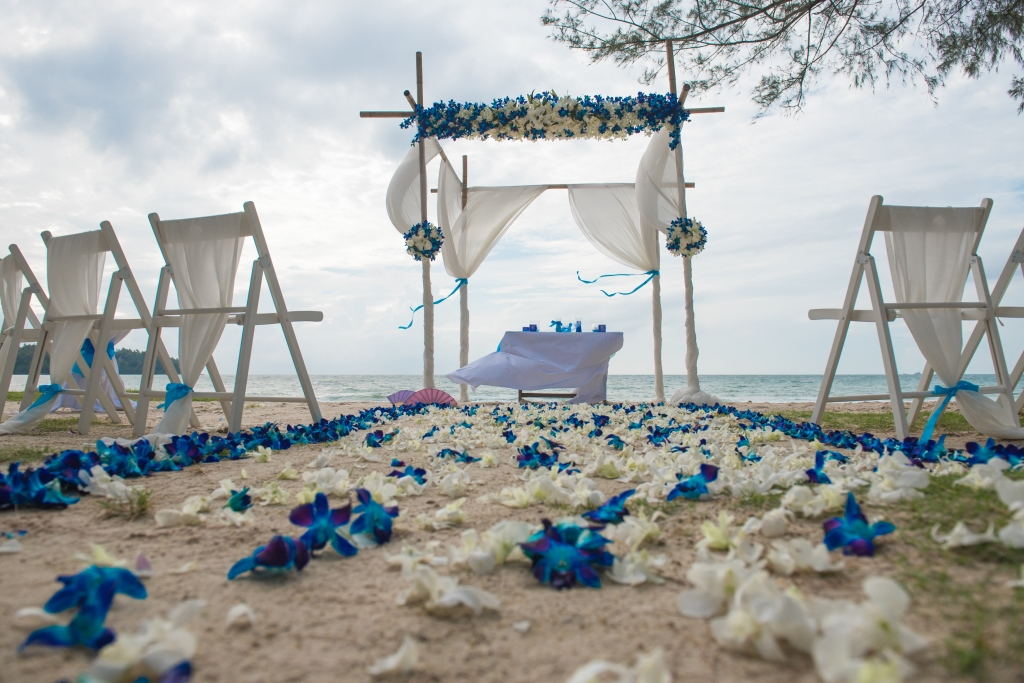 Stunning bamboo archdecorated in white and blue fresh flowers designed by Flowers By Toom.