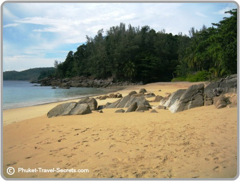 Rock formations in the center of the beach on Banana Rock Beach in Phuket.
