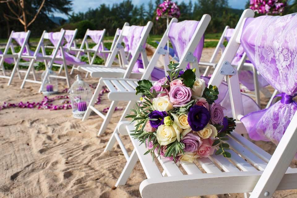 Decorated chairs with purple for a striking wedding in Phuket