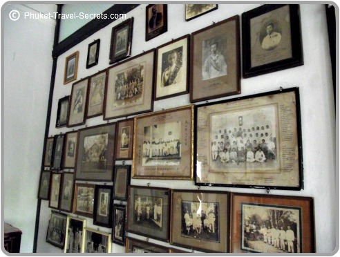 Old family photos line the walls of the mansion.
