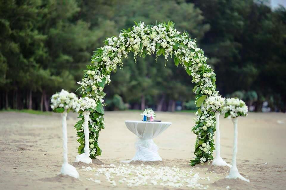 Green and white floral arch for beach wedding in Phuket