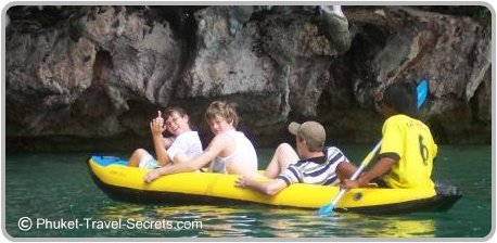 Our kids love activities like the sea canoe in Phang Nga Bay.