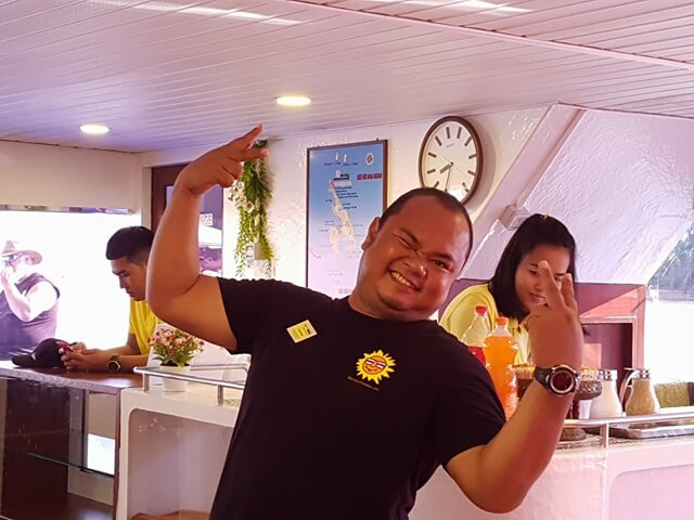 Our fantastic guide Mr Ti on-board the ferry