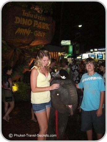 Kids feeding the baby elephant at Dino Park in Phuket.