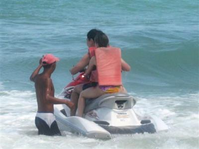 Jet ski operator giving instructions to the unlucky first timers.