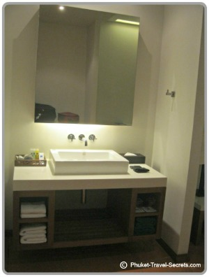 The handbasin and mirror is positioned outside the shower area.