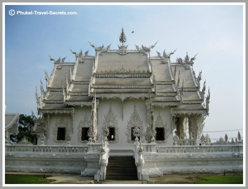 Side view of the White Temple Assembly Hall in Chiang Rai.