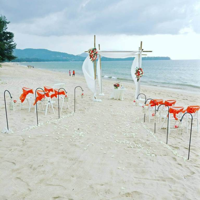 orange theme simple beach wedding setup in phuket