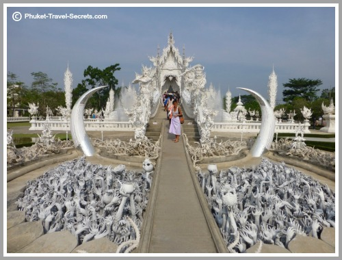 Picture showing hands reaching up from the pit of hell at the White Temple in Chiang Rai.