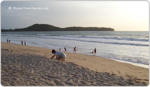 Our son having a ton of fun at Bangtao beach in Phuket.