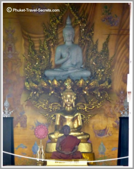 Buddha Images inside the main assembly hall at the White Temple, the picture was taken from outside looking in..