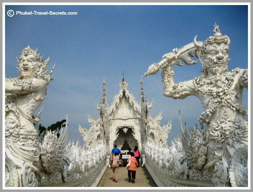 Guardian Statues guard the bridge at the White Temple in Chiang Rai.