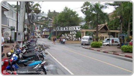 Kata Beach Resort corner, to the left the Niki store, to the right the local songthaew bus stop.
