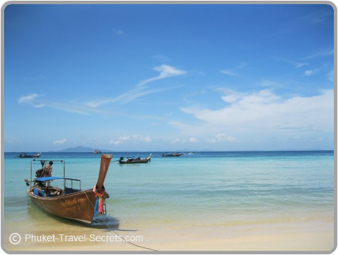 Longtail boats provide transport to nearby islands in Phuket, Krabi & Phi Ph