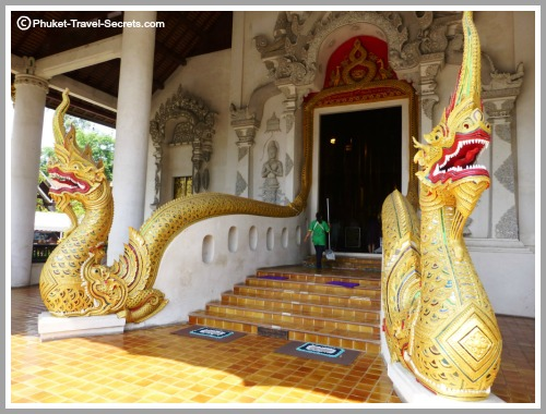 Methodological serpents winding their way up the stairs and around the doorway of the main Viharn at Chedi Luang..