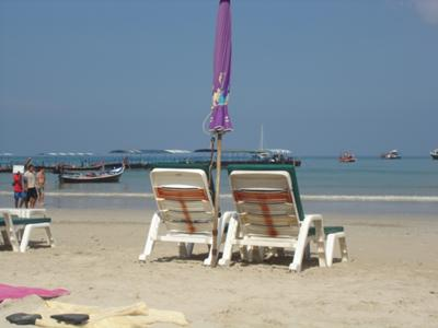 Early morning at Patong beach ready to catch a longtail boat to a secluded beach