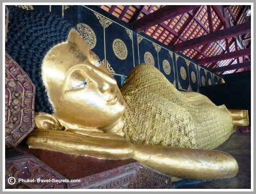 The Reclining Buddha is situated in an open sided pavilion just near the Chedi.